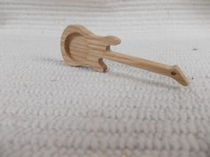 1 p unfinished guitar-shaped pendant base with 18 mm round cutout    https://www.etsy.com/listing/601119675/new-1-p-unfinished-guitar-shaped-pendant?ref=shop_home_active_12