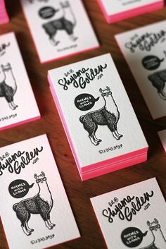 Pink edges and llamas on these cute business cards