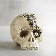 Pier 1 Imports Bejeweled Skull Halloween Decor ($20) ❤ liked on Polyvore featuring home, home decor, holiday decorations, ivory, skull home decor, pier 1 imports, handmade home decor, skull home accessories and halloween centerpieces