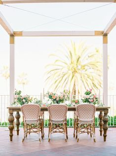 We are deeply in love with this intimate garden wedding inspiration with an iron gate ceremony backdrop adorned in blooms, a lush flower aisle with raunculus in lots of pink shades and embroidered lace bridal separates that take the wedding fashion to a whole new level!