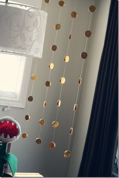 Super Mario Party - gold coins----this would also make a cute nursery decoration