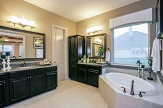 Gehan Homes Master Bathroom - Black cabinet, gray granite countertops, corner drop in tub, oil rubbed bronze, tan walls, dual sinks. Houston, Texas   Westover Park Classic - Princeton #Gehanhomes