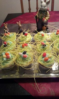 Easter Egg Nest Cupcakes - use your basic cake mix, make a butter frosting with a bit of natural food coloring - buy edible Easter grass & candy eggs made from grape juice - decorate to your heart's content
