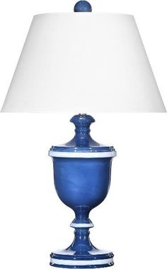 """This lovely lamp is made with moisture controlled clay from Nove, Italy. The lamp features a blue finish with white accents and is topped off with a clean white shade. The lamp measures 30""""H and the s"""