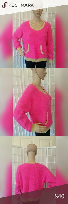 Nwt Juicy Couture sweater top shirt Nwt Juicy Couture sweater top shirt   Hot pink and gold  Excellent condition no flaws   Material content  60% cotton 40% nylon  Measurements approx  Chest 46in Sleeve 19in. Length 20in. Juicy Couture Sweaters