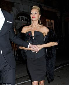 Muscly figure: Tess shows off her super-toned physique in the strapless outfit