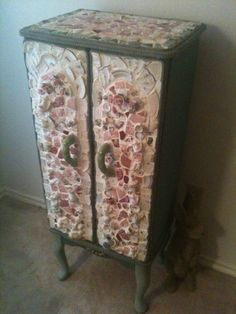 I covered an old jewelry armoire in broken china