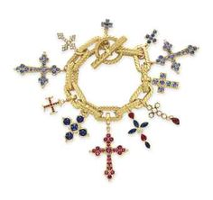 A MULTI-GEM AND GOLD CHARM BRACELET   Suspending eleven multi-gem cross charms, from an 18k gold open link chain signed Tiffany & Co., 8½ ins.