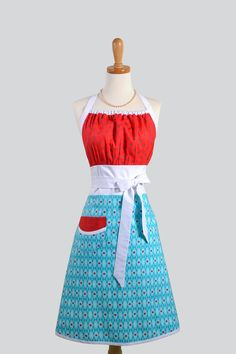 This Kitsch apron explodes with colors of teal, red and white.