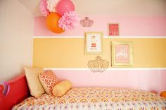A small space turned into a fabulous pink and tangerine toddler room.  #toddler