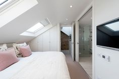 To create a rear dormer loft conversion to a mid-terrace floor maisonette to a home in Balham, South London. Further space within the property has been renovated by delivering an additional bedroom, and fully fitted bathroom. Bedroom With Ensuite, Small Room Bedroom, Small Rooms, Modern Bedroom, Small Loft Spaces, Master Bedroom, Attic Spaces, Master Suite, Loft Conversion Decor