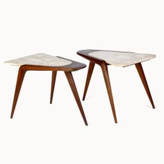 Vladimir kagan; Walnut and Travertine End tables, 1950s.