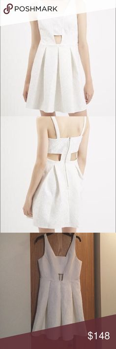 TOPSHOP Women's White Bonded Lace Skater Dress Look amazing in this lace derail dress by topshop. The dead is fit and flare with key hole detail in the front and bonding like detain in the back. Topshop Dresses Mini
