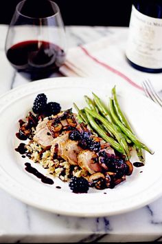 seared pork tenderloin and sage caramelized mushrooms with blackberry red wine reduction