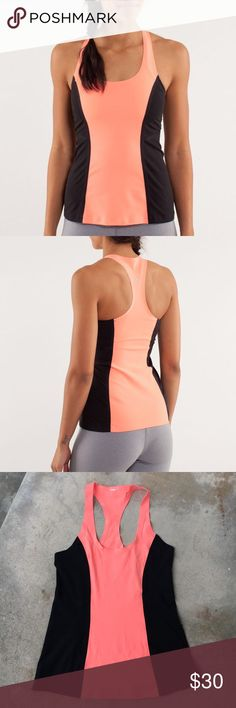 "Lululemon Cool Racerback Surf Bonded Classic Lululemon tank with back side panels for a very flattering fit. Worn once. 100% sure that this is a size 8 (found my receipt online). Color has some pink and is more coral than a true ""orange"".   🍊 Size: 8, length 24"" bust 14"" 🍊 Condition: like new 🍊 Color: pop orange & black  🧡 OFFERS welcome, but please use button. I don't discuss in comments ✖️ No trades, holds, or modeling lululemon athletica Tops Tank Tops"