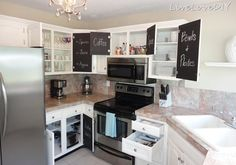 DIY Chalkboard Paint Kitchen Cabinets! I'd never do this to my cabinets but it is kinda cute, especially if you have older cabinets you want to spruce up!
