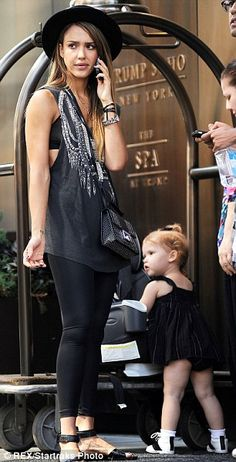 Dressing for Fashion Week: Alba wore a casual but trendy ensemble of black leggings, embellished grey tank top and black hat for her day out...