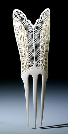 Tall Chinese export comb with roses, a symbol of luck, on a carved lacy background. c. 1890. The Barbara Steinberg Collection, given to the Creative Museum.