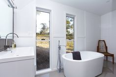 Free standing bath with a view! Living Green Designer Homes #interior #homes #construction #sustainability #livinggreendesignerhomes