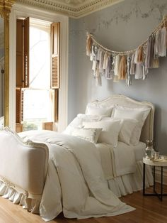 Make your own tassels to use as decor and they become a piece of art. In this bedroom, you can see how the tassels are a feminine and soft touch in colors that are neutral, complementing the rest of the decor. They add great texture to a room as well!