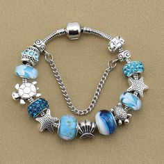 This sea life themed beaded bracelet will show off your beach style. BRACELET DETAILS - Length: 18 cm or 20 cm - Metal: antique & tibetan silver plated - Beads: Glass, crystal, alloy & silver plated 1 More