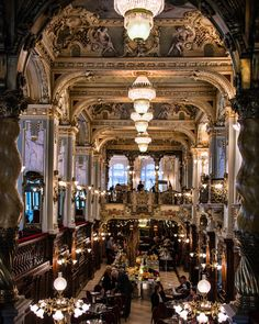 """the Boscolo Budapest's greatest draw is the New York Café, a traditional coffeehouse of muraled ceilings and gilded columns that was at the forefront of Budapest's café scene at the turn of the 19th century."""