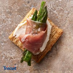 Prosciutto-wrapped asparagus with soft Swiss cheese on a Triscuit adds a sophisticated touch to your Easter appetizers, without the fuss.
