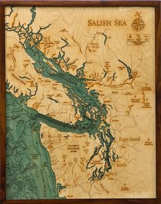 Beautiful map of the Salish Sea carved out of wood.
