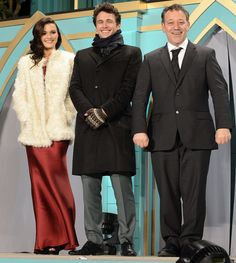 Rachel Weisz Fur Coat - Rachel Weisz paired her elegant red dress with a classic white fur coat for the premiere of 'Oz the Great and Powerful' in Japan.
