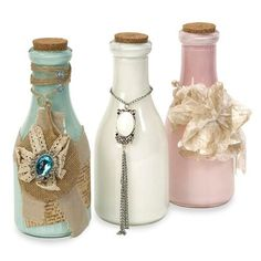 IMAX Victoria Vintage Bottles - Set of 3 - 72018-3. IMAX Victoria Vintage Bottles - Set of 3 - 72018-3 Adding a vintage touch to any room, this set of three revamped bottles have painted interiors and are wrapped in lace, tulle, ribbon, burlap and embellished with a mix of Sha.. . See More Vintage items at http://www.ourgreatshop.com/Vintage-items-C732.aspx