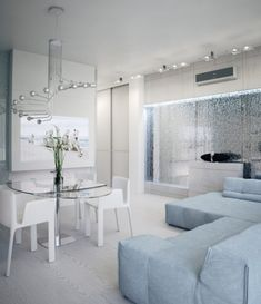 Glacial White Takes Over The Futuristic Apartment By Alexander Lysak