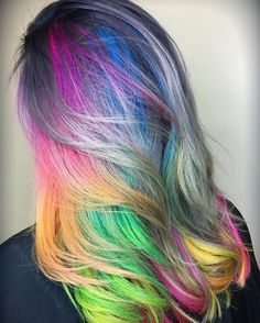 A rainbow through the clouds ☁️☁️ I love the contrast between the neons and metallic tones here. I just love contrast period...it keeps you on your toes ;) @kenraprofessional #metallichair #neonhair #rainbowhair #haircolor #colorfulhair #hair