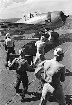 Pilot in an F6F waits for the take-off signal on board the USS Lexington.