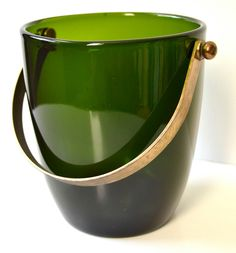 Vintage Green Glass Ice Bucket with Brass Handle. $65.00, via Etsy.