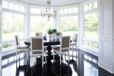 dark table white chairs