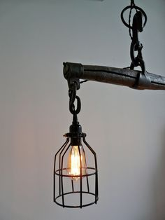 This antique, wooden oxen yoke light is an absolute show-stopper! An authentic turn of the century horse harness has been upcycled into a beautiful farmhouse rustic light.    The wooden yoke and cast iron fittings have all been clear coated with a matte finish to maintain the vintage patina.    Fixture is direct wire and includes a black canopy kit.    I use only high quality, UL listed lighting parts in my designs.  Two 60W Edison bulbs are included.    SIZE:    overall width: 27  bulbs are…