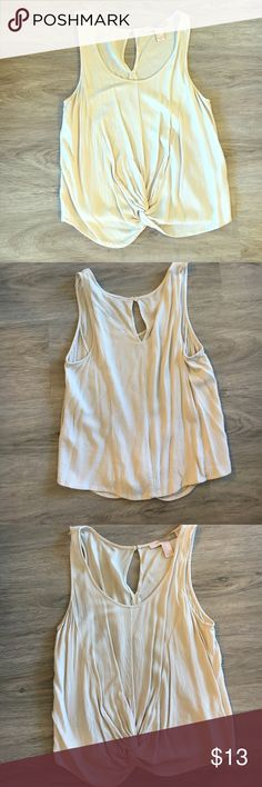 S forever 21 twisted waist tank top Twisted waist tank tank with key hole back. Size small. Cream / off white colored. Shoulder has small snag but you cannot see it unless it's inside out Forever 21 Tops Tank Tops