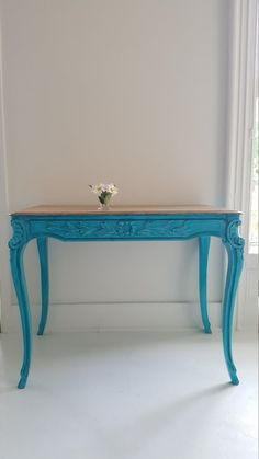 Stunning turquoise vintage table. Vintage oak from Belgium. Elegant and rustic nice size, not too big or small. Great design and fun paint color make it a lovely piece of functional art.  Could be used as a desk, vanity, bedside table, hall table, kitchen table, etc.  375.  Length 37in Width 22in Height 29in  ☺please contact me for shipping. I will need your zip code to give you a price for shipping.  I am located in Central NJ. Pick up and delivery are available.   I Will also paint yo...