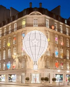 """DIOR, 30 Avenue Montaigne, Paris, France, """"Dior is brought to breathtaking life for Christmas with a host of hot-air balloons rising from its famous facade. Like fireflies glowing in the dark, the Cruise 2018 themed installation features the Motherpeace tarot by Vicki Noble and Karen Vogel that so inspired Maria Grazia Chiuri"""", pinned by Ton van der Veer"""