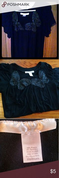 Black Women's shirt with butterfly patterns Nice casual black shirt with two butterflies that go around the front neck line of shirt. Tops