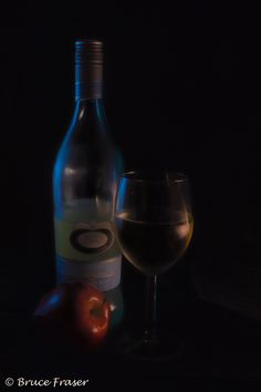 L2M2AS1_Dark indoors with a hint of reflected light - Indoor image, camera was placed on a Manfrotto tripod in manual mode with LED lighting placed on either side of the still.  The wine was taken out of the fridge and placed in a warm environment to crea