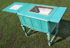Old sewing machine cabinet turned into outdoor entertaining table.