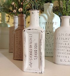 Cathe Holden: Embossed Bottles, suggests light color paint is better than dark to allow more contrast.