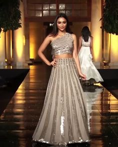 Manish Malhotra Look 20 - Beautiful Embroidered Beige Two Piece One Shoulder A-Lane Evening Maxi Dress. Contemporary Art 2019 Runway Show Collection by Manish Malhotra Source by shivipin - Party Wear Indian Dresses, Indian Gowns Dresses, Dress Indian Style, Indian Wedding Outfits, Bridal Outfits, Indian Outfits, Dresses Dresses, Indian Weddings, Dance Dresses
