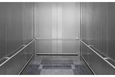 CabForms 1000-A Elevator Interior in Stainless Steel with Sandstone finish and Dallas Impression pattern; Round handrails in Satin Stainless Steel; Latitude Bumper System in D configuration at the Indianapolis International Airport, Indianapolis, Indiana