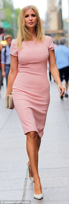 Walking the walk: Ivanka Trump sported a figure-hugging pink dress on her first…