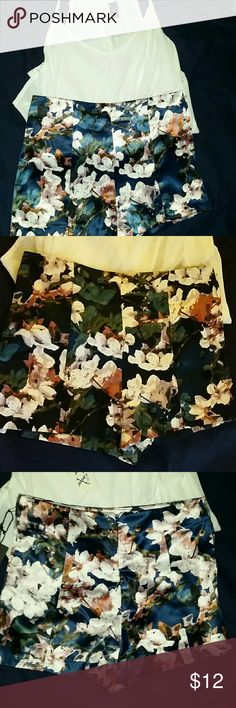 Satin floral shorts These shorts are high waisted, satin - like floral shorts with zipper in the back. New with tags, size small Forever 21 Shorts