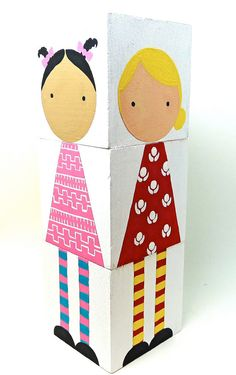 These adorable wooden dolls are made up of three 2 blocks that can be stacked and matched together in a variety of different ways to create different outfits. Rotate the dresses, mix up the tights, change the heads! The stack stands together at 6 tall. The dress colors are turquoise, red pink