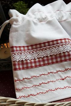 simple touches of red stitching, lace, and gingham.....pretty idea for adding pizzaz to a purchased dish towel too.