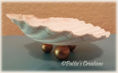 A sea shell that I added beads as feet. I use it in my bedroom to place small treasures in. I have my rosary beads in them.